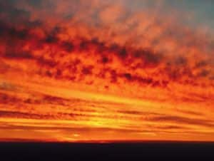 The vibrant yellow-orange color of a sunset is a signature of air pollution, according to a report in 'Scientific American.' Credit: Jeff Joslin
