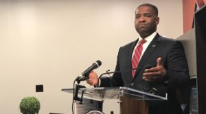 """Atlanta City Council President Ceasar Mitchell, pictured in his City Hall office on Thursday, is defending his proposal for a moratorium on contracts that begin service in 2018, against heated criticism from Mayor Kasim Reed. Reed has called the idea a """"donor protection bill"""" in Mitchell's bid for mayor."""