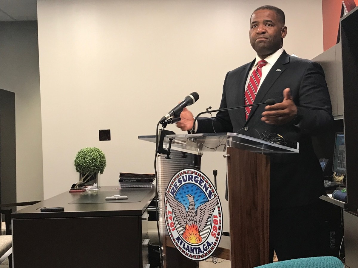 "Atlanta City Council President Ceasar Mitchell, pictured in his City Hall office on Thursday, is defending his proposal for a moratorium on contracts that begin service in 2018, against heated criticism from Mayor Kasim Reed. Reed has called the idea a ""donor protection bill"" in Mitchell's bid for mayor."