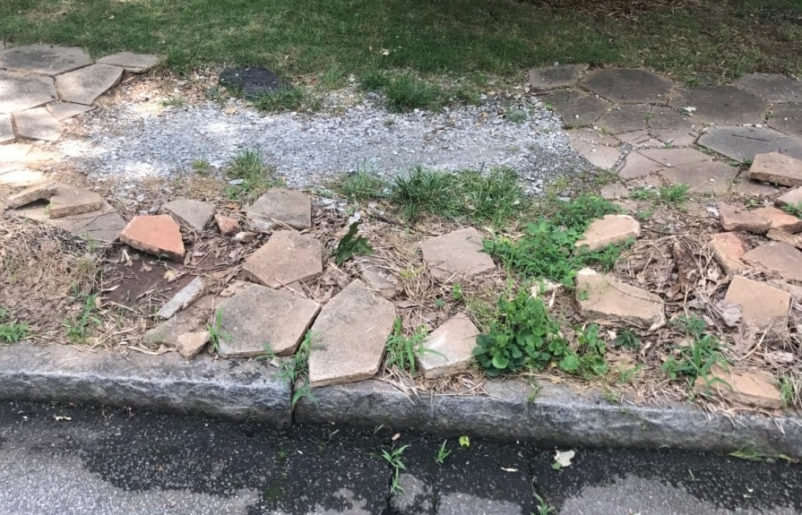 A broken sidewalk in Candler Park. (File/Credit: Kelly Jordan)