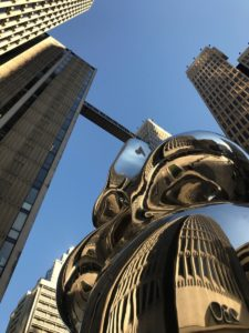 sculpture in front of 230 peachtree street, aerial bridge