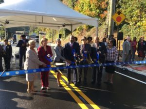 Atlanta city leaders prepare to cut the ribbon to officially reopen Lyndhurst Drive after $6.3 million in works. Credit: Maggie Lee