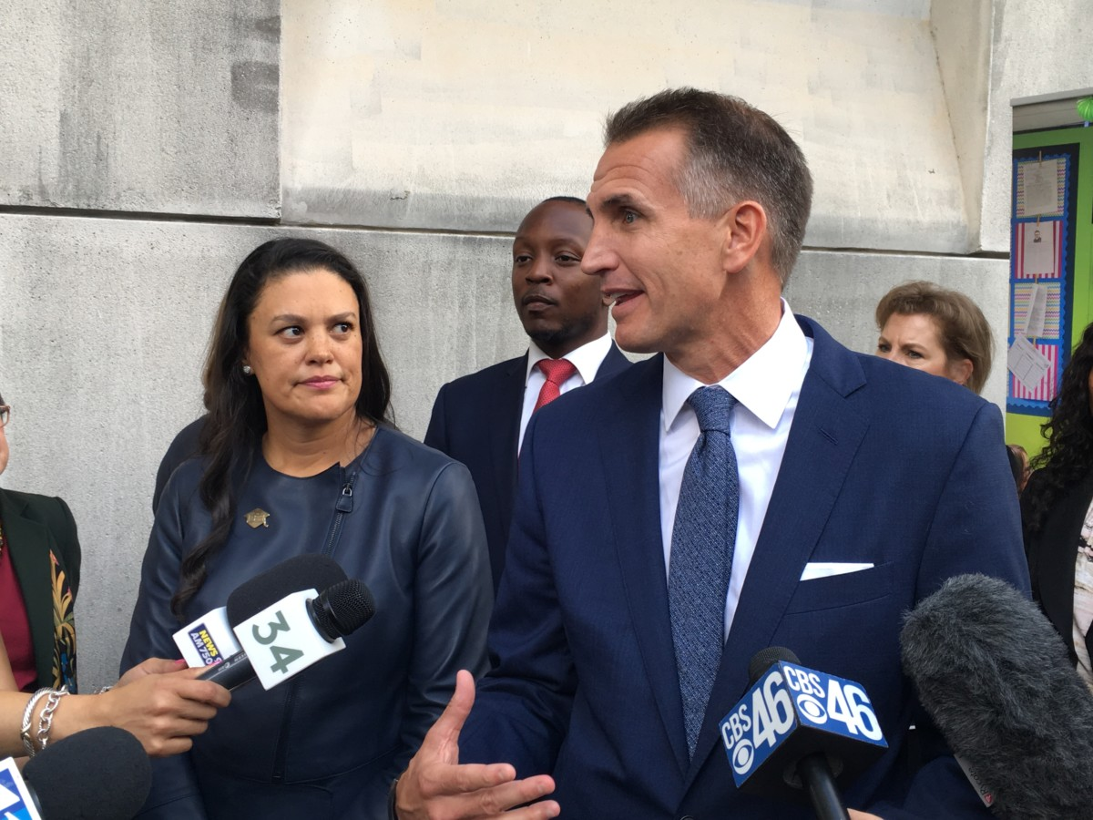 The superintendents of Atlanta and Fulton schools, Meria Carstarphen and Jeff Rose, outside the Fulton County Courthouse on Friday, both expressed frustration with Fulton County's troubled property tax assessments. Credit: Maggie Lee