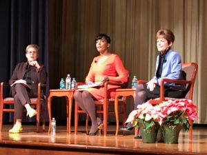 Cathy Woolard, in her trademark yellow tennis shoes on Tuesday night, quizzed the two women who made it into the third round of the mayoral race: Keisha Lance Bottoms and Mary Norwood. Credit: Maria Saporta