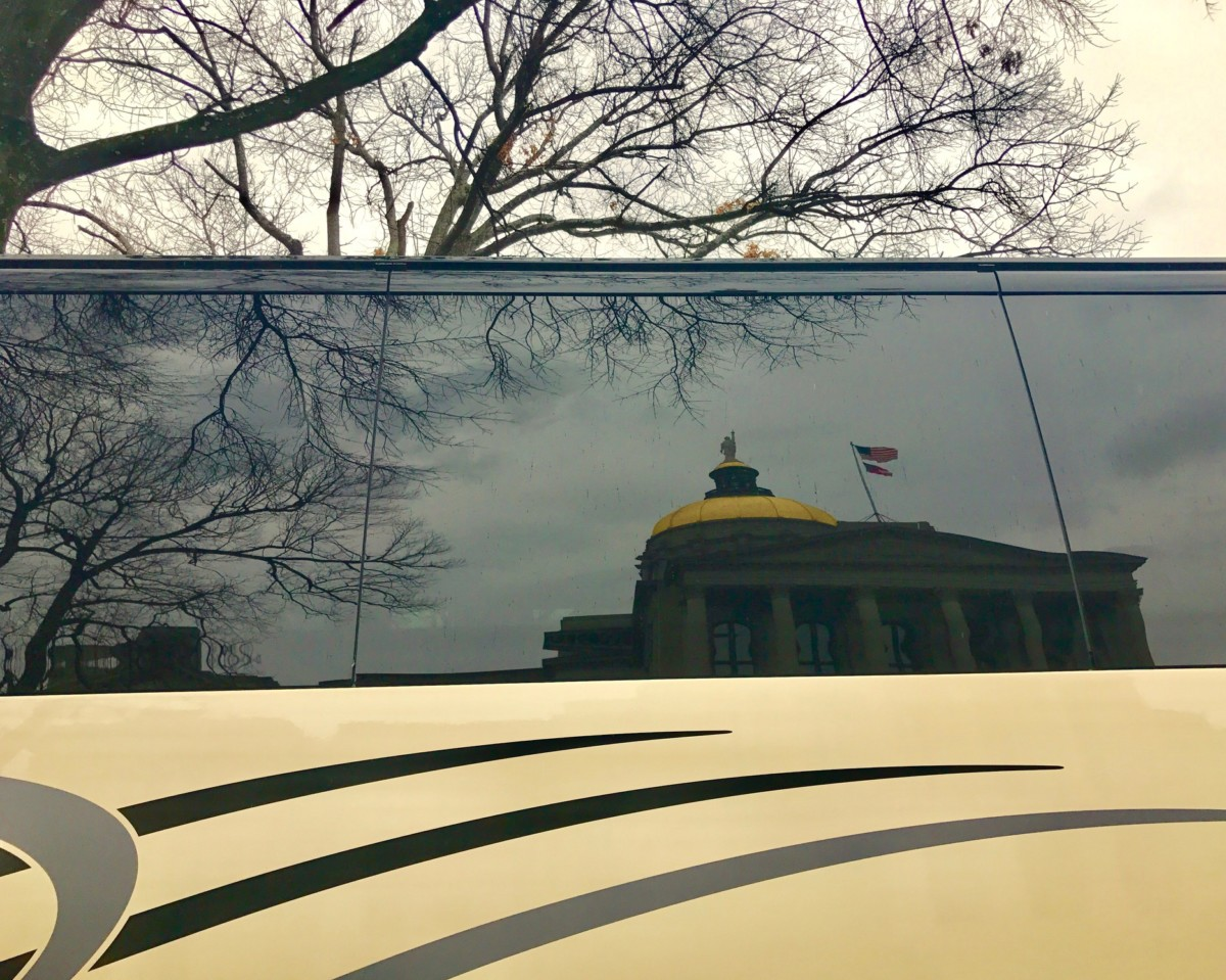 The Gold Dome of the state Capitol reflected in a bus window. Credit: Kelly Jordan