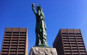 """A Statue of Liberty, framed by the James H. """"Sloppy"""" Floyd state office building in Downtown Atlanta. Credit: Kelly Jordan"""