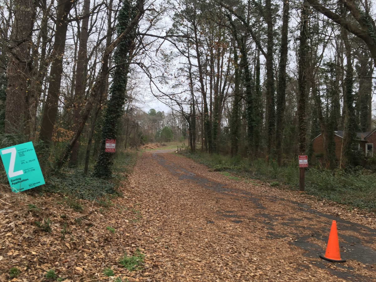Fall leaves still lie on Thress Street, which dead-ends into Ormewood Forest in southeast Atlanta. A sign announces a request to rezone the area. Credit: Maggie Lee