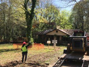 Demolition began Thursday on a Southwest Atlanta home that neighbors have been complaining about since 2015. Credit: Maggie Lee