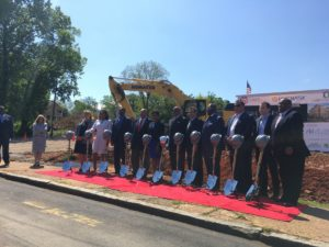 Officials and organizers pose at the ceremonial groundbreaking for The Legacy at Vine City on Friday. It will be an apartment building for seniors, priced below market rate. Credit: Maggie Lee