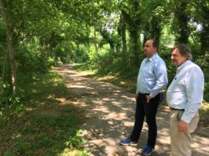 Atlanta City Councilman Dustin Hillis (l) and Keith Sharp of Riverwalk Atlanta on a bit of riverside trail that's been closed for years. Credit: Maggie Lee