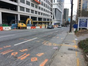 Across the street from 1109 West Peachtree in March this year — a utility pole and construction barriers block sidewalks. Credit: Special to SaportaReport
