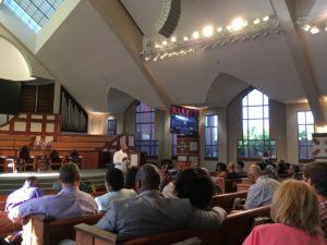 Rev. Raphael Warnock addressed more than 100 people Wednesday night. Credit: Maggie Lee
