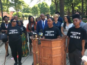 """LaQuanda Smith was bailed out of jail by campaigners who say the system is unjust to poor folks who can't pay. """"I was in there with people who had a thousand dollars bail and couldn't even afford $100,"""" said Smith, at a Tuesday press conference at Ebenezer Baptist Church. Credit: Maggie Lee"""