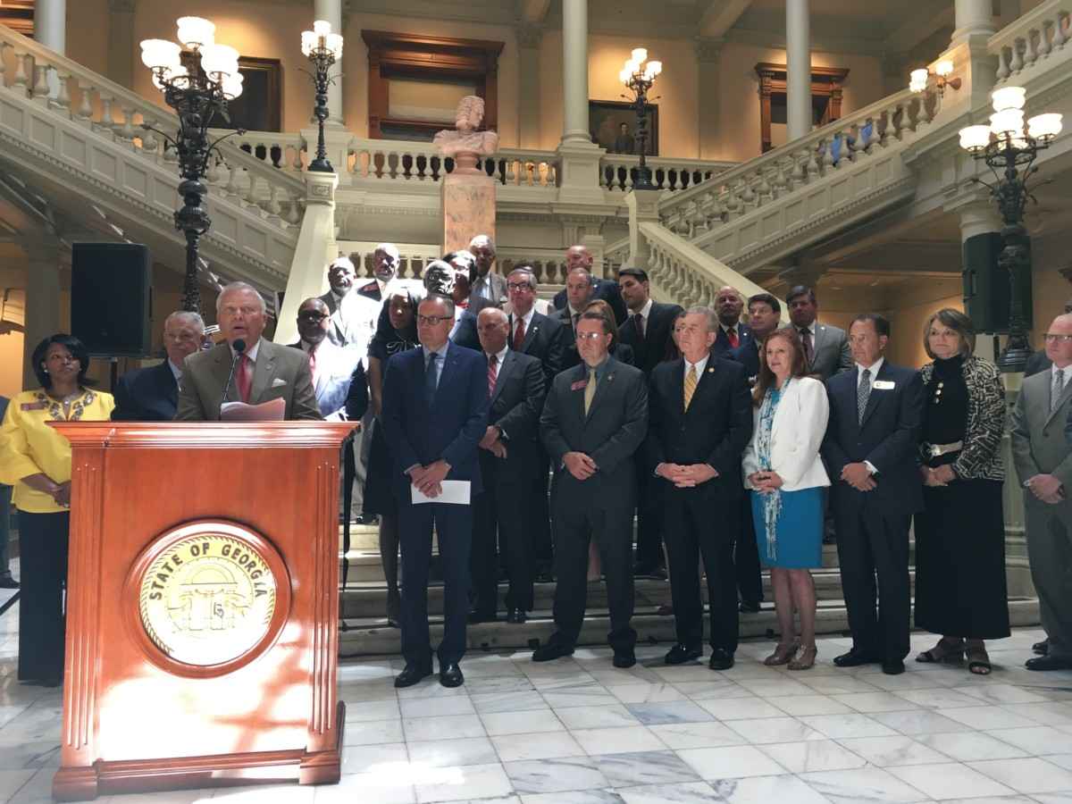Georgia Gov. Nathan Deal, backed by state, county and city elected leaders on Tuesday, announced the $100 million spend on GA 400 rapid bus infrastructure. Credit: Maggie Lee