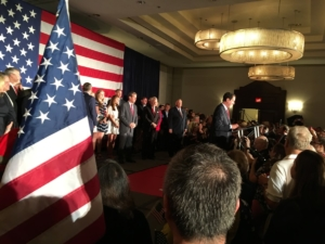 After a rough primary season, Georgia GOP Chairman John Watson emceed a Republican unity rally Thursday, with numerous party leaders on stage and rallying a crowd. Credit: Maggie Lee