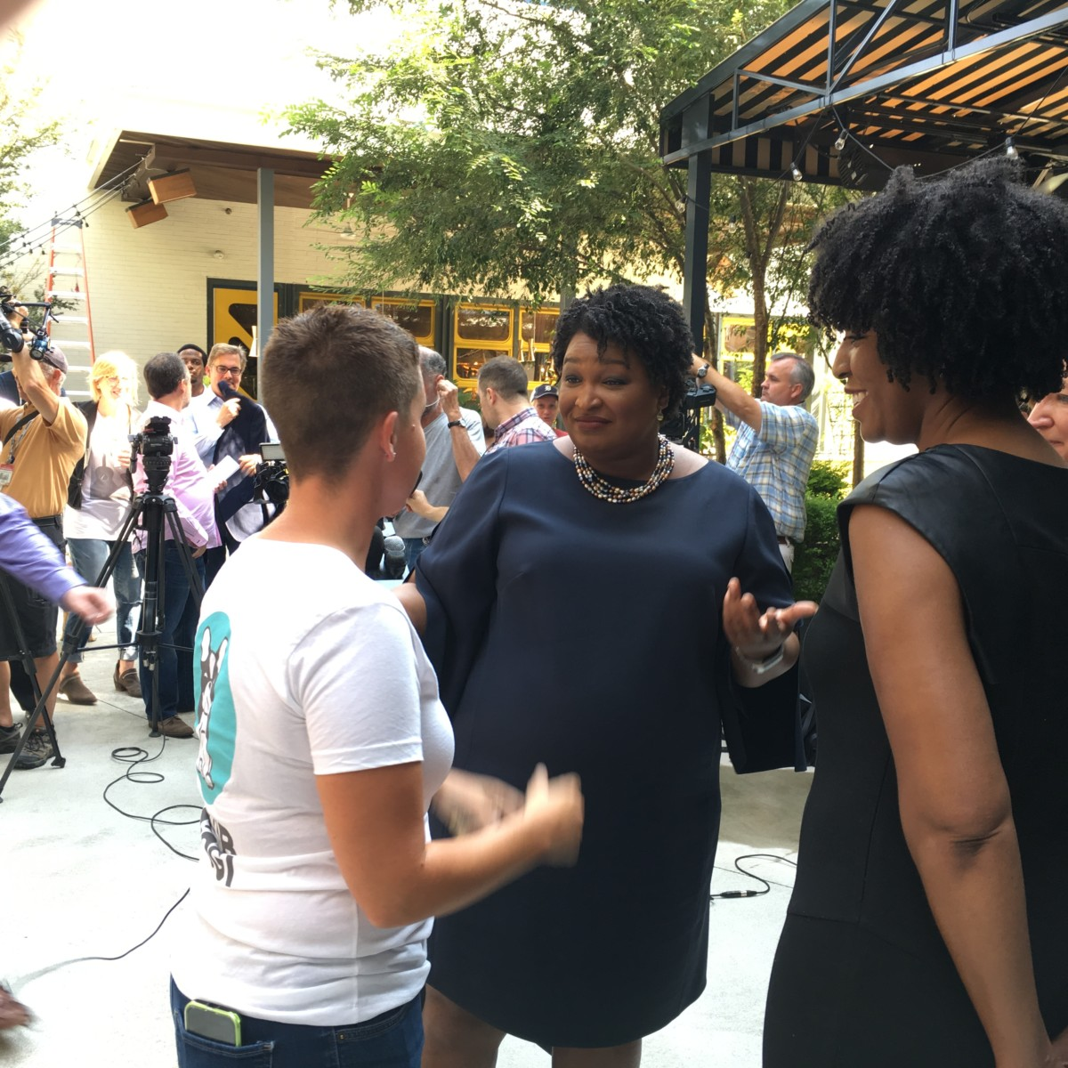 Stacey Abrams, Georgia's democratic gubernatorial candidate, speaks with supporters after an Atlanta press conference on July 27, 2018. Credit: Maggie Lee