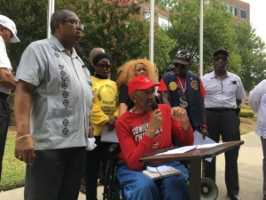 John Evans, a former MARTA board member, speaking in front of agency headquarters on Thursday, demanding in the name of equity better south and east DeKalb MARTA service. Credit: Maggie Lee