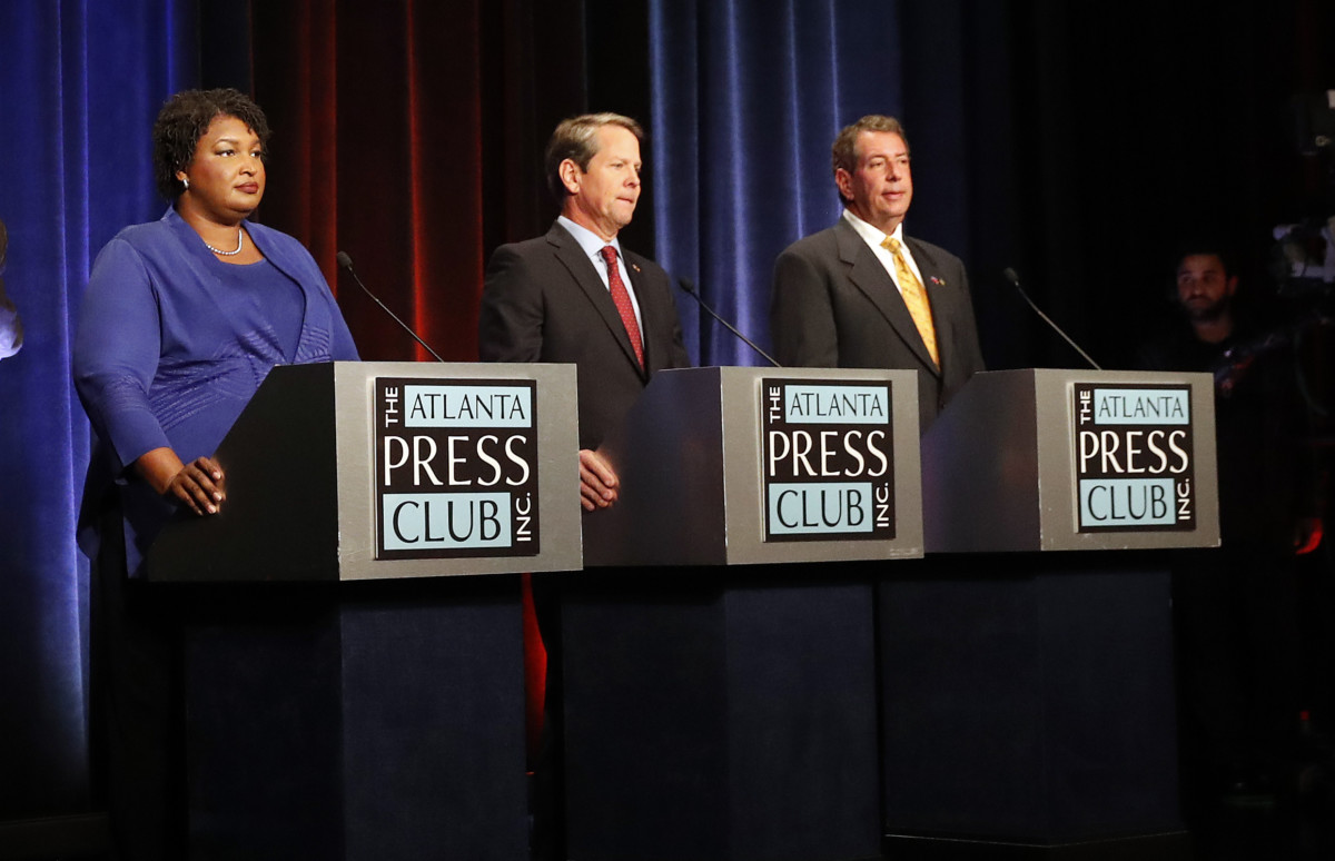 Candidates for Georgia Governor from left; Democrat Stacey Abrams, Republican Sec. of State Brian Kemp, and Libertarian Ted Metz, right, during a pause in a debate on Tuesday, Oct. 23, 2018, in Atlanta. Credit: AP Photo/John Bazemore