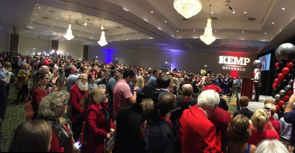 A crowd at Brian Kemp's watch part in Athens cheers for Gov. Nathan Deal and his wife Sandra Deal. Credit: Maggie Lee