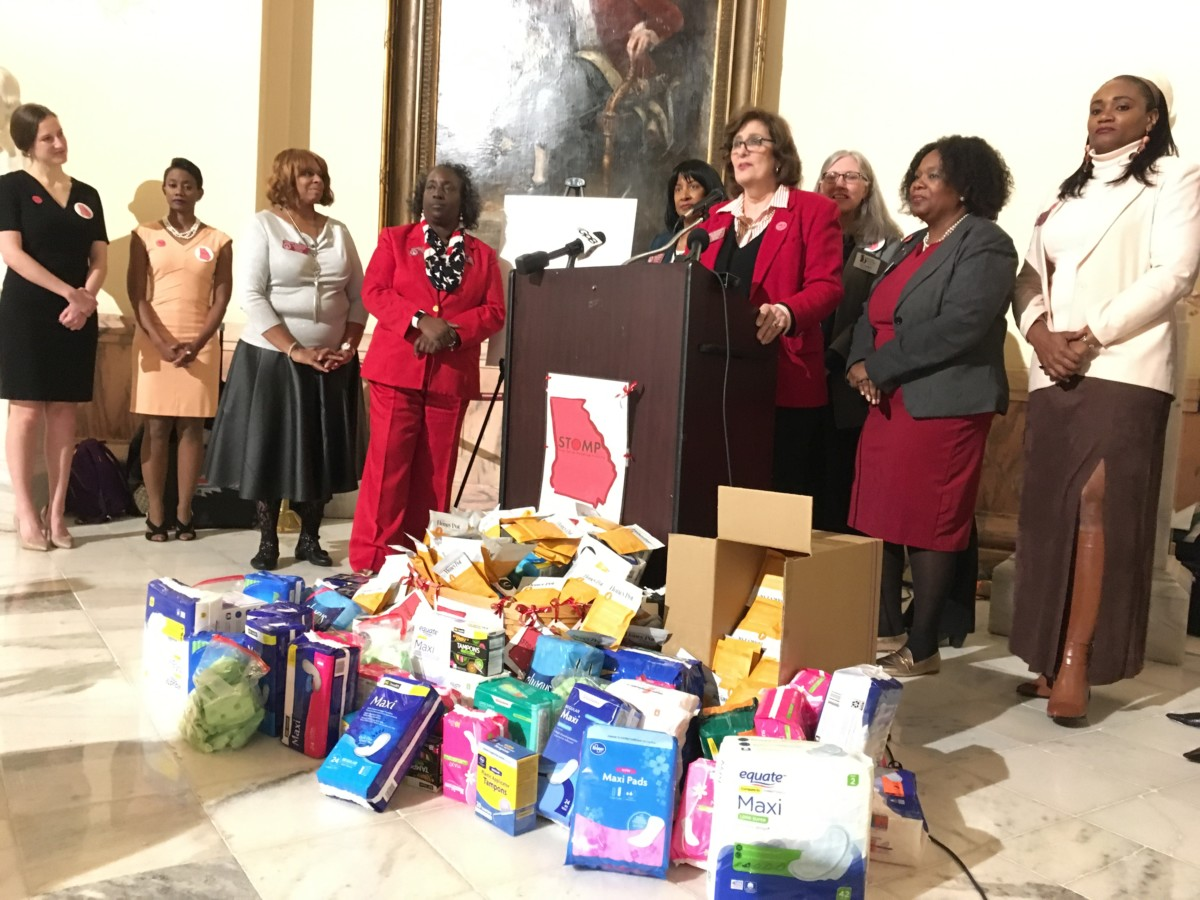 State Rep. Debbie Buckner, D-Junction City, speaking at the state Capitol on Tuesday, joined others in calling for an end to the state sales tax on menstrual products. Credit: Maggie Lee