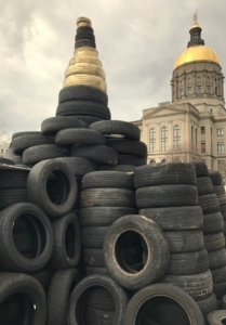 A file photo from March 2017 shows tires heaped outside the Georgia state Capitol in protest of diversion of tire cleanup money. Credit: Kelly Jordan