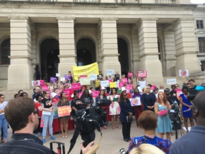 Opponents of House Bill 481 gathered on the Capitol steps on May 7, 2019 as inside, Gov. Brian Kemp signed the near-total ban on abortion. Credit: Maggie Lee