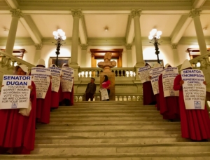 A file photo from March shows what was a common site at the Capitol this year: people protesting 481, dressed as women from The Handmaid's Tale, a book set in a theocratic America that subjugates women completely. Credit: Kelly Jordan