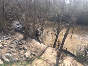 A silt fence keeps some of the dirt out of Intrenchment Creek. But the fight against pollution is ongoing in south DeKalb's waterways. Credit: Jacqueline Echols