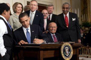obama signs ACA