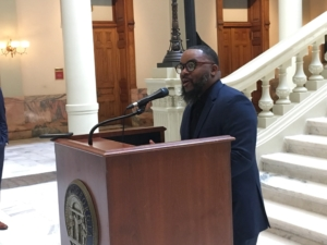 """""""Because they're not being collected, those are dollars that are not being used in our communities, and for me, that's a problem,"""" said Billy Honor, at a state Capitol press conference on Tuesday. Credit: Maggie Lee"""