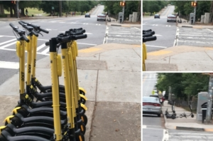 By Piedmont Park in Midtown: numerous unused scooters parked to the side and in the background, scooters blocking the sidewalk. Credit: Maggie Lee