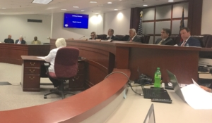 Public Service Commission members sitting in hearing on July 16