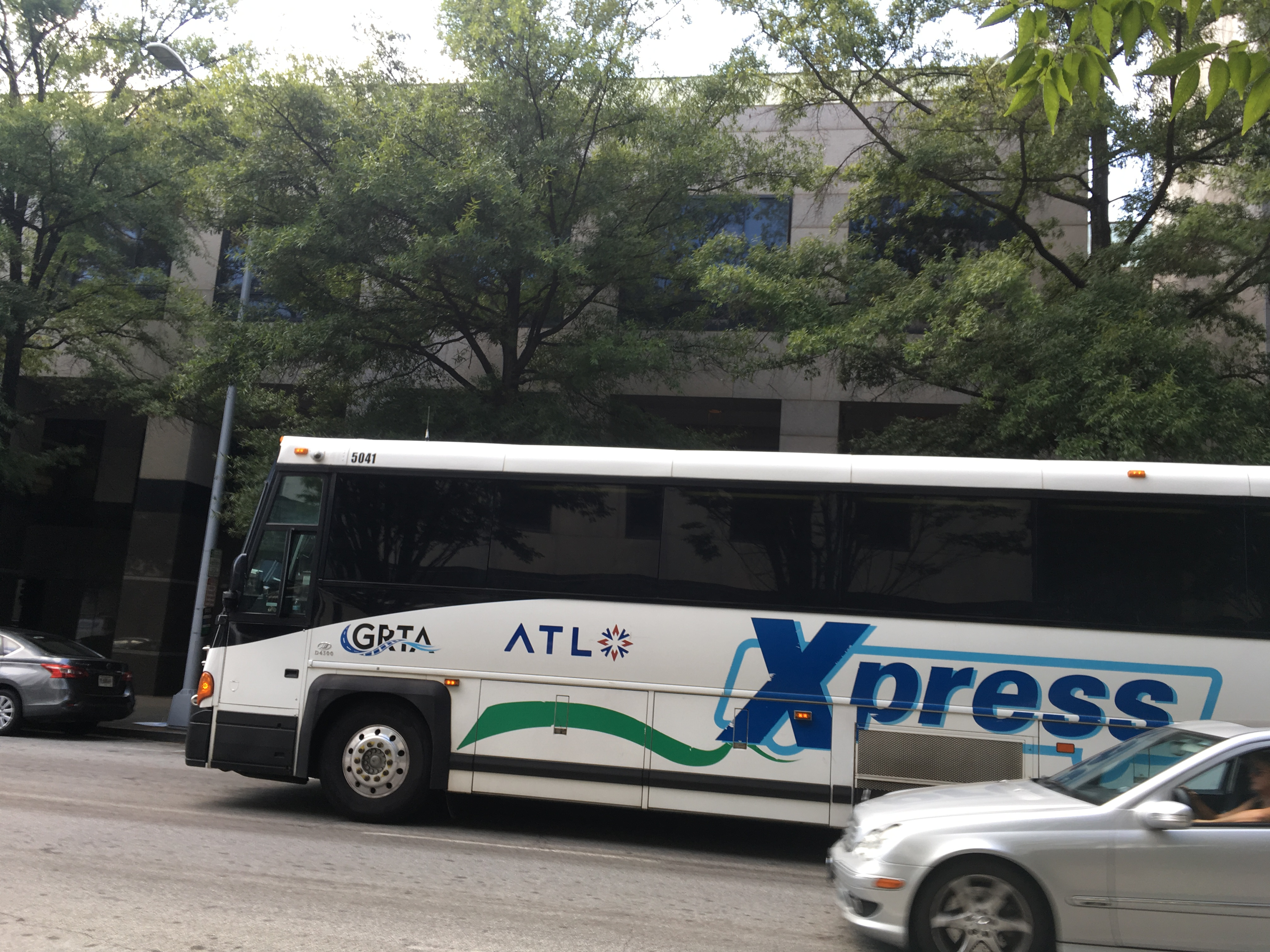 Xpress bus with The ATL logo (FIle/credit: Maggie Lee)