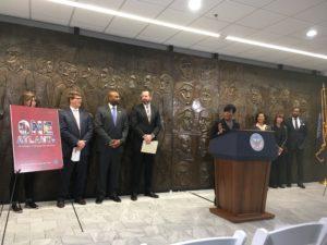 Atlanta Mayor Keisha Lance Bottoms at City Hall podium with Josh Rowan and others