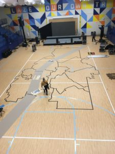 This year, Harper-Archer Elementary hosted the Atlanta Public Schools State of the District event. The school is a new merger between Towns and Fain elementaries. It's in the onetime Harper High School building, which has just been renovated. On the gym floor, a map of Atlanta is laid out in tape.