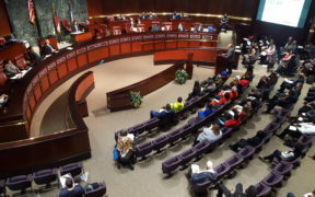 The Atlanta City Council chambers are crowded with affordable housing advocates.