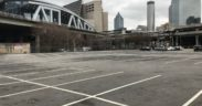 "A mostly empty parking lot in Downtown Atlanta's ""Gulch"""