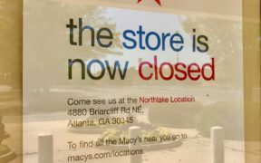 """Sign in South DeKalb Macy's window reading """"the store is now closed..."""""""