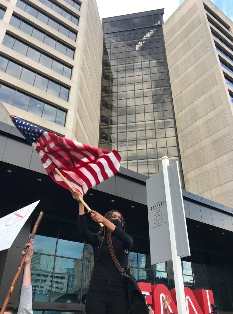 A man waving a U.S. flag