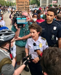 Atlanta Police Chief Erika Shields in a crowd of reporters and protestors