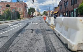 Temporary barriers cut part of Edgewood Avenue into just two lanes. (Credit: Sean Keenan)