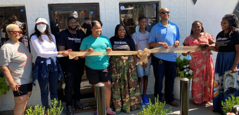 Family of namesake Claudia Kemp cut the ribbon on Claudia's House July 14, 2020 with Fulton County Commissioner Natalie Hall. L-R: Cynthia Hines, Commissioner Natalie Hall, Anthony Gates, Mariah Hines, Larenzia Lawrence, Nick Woods, Marvin Hines, Shon Hines and LaTonya Gates. Credit: Special