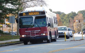 Gwinnett County Transit 2002 Orion VII CNG on the 35 Bus on Spalding Drive heading to Doraville MARTA Station