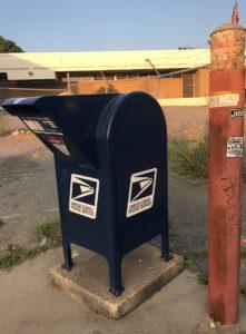 USPS mailbox on sidewalk
