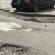 These potholes on Early Street, in Buckhead, illustrate the extent of the pothole problem if repairs weren't made. This area is near a construction zone. Credit: David Pendered