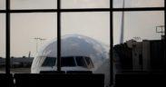 Delta airplane at concourse Atlanta airport