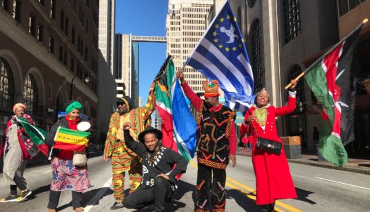 MLK Day Parade 2018 2019 2020 downtown Atlanta Peachtree Street flag