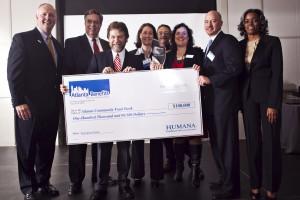 Bill Bolling accepts $100,000 check from Humana representatives