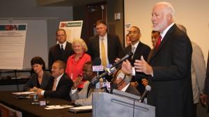 Bucky Johnson presides over a press conference after the adoption of a $6.14 billion proposed transportation list. Credit: Barry Golivesky, Atlanta Regional Commission