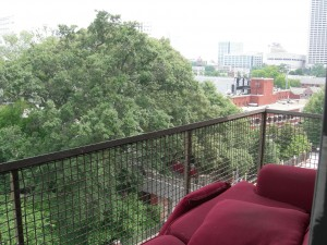 Our 7th floor balcony. The trees have grown to hide the view of Grant Field.